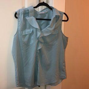 light blue sleeveless blouse